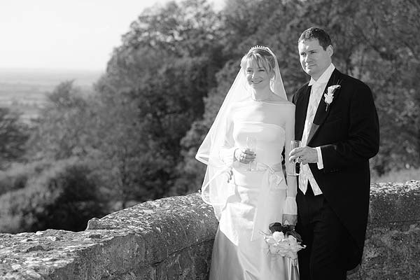 black and white photo of wedding couple admiring the view from Lympne Castle